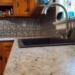 New counter, sink, faucet, and back splash