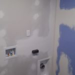 Drywall taped, mudded, sanded, and ready for paint